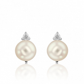 Puces d'oreilles perle d'eau douce, diamant et or blanc 18 carats